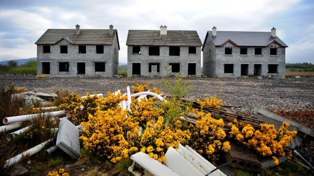 Unfinished homes sit empty on an abandoned housing development in Ireland. The OECD is warning Canada on its hot housing market.