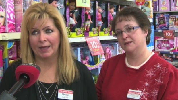 Annette Costigan and Tina Thompson, who work at The Bargain Shop in Labrador City, say they were happy to tell three layaway customers that their purchases had been paid off.