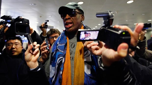 Dennis Rodman is mobbed at Beijing Intl. Airport prior to catching a connecting flight to Pyongyang, North Korea, on Thursday.