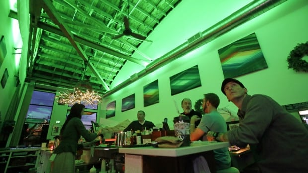 Lightbar patrons sit in a green glow from special lights in Portland, Ore., on Thursday to help those with seasonal affective disorder, or SAD.