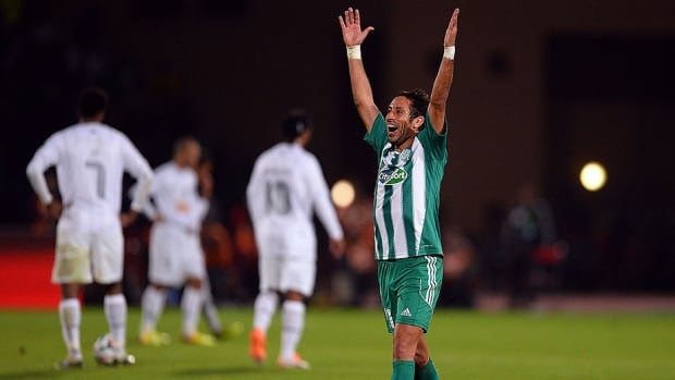 Adil Karrouchy of Raja Casablanca celebrates the club's shocking victory over Atletico Mineiro in the semifinals of the Club World Cup on Wednesday.