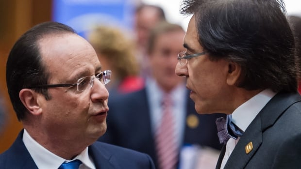 French President Francois Hollande, left, talks with Belgium's Prime Minister Elio Di Rupo, during an EU summit in Brussels, Dec. 20 2013. They were among the European Union leaders deriding S&P for downgrading the EU credit rating.