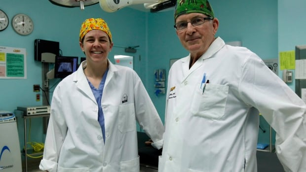Conservative MP and doctor Kellie Leitch, left, stands with Dr. Baxter Willis, chief of surgery at the Children's Hospital of Eastern Ontario in 2012. Leitch volunteers her time at the hospital to keep her credentials current, while holding down two federal cabinet posts.