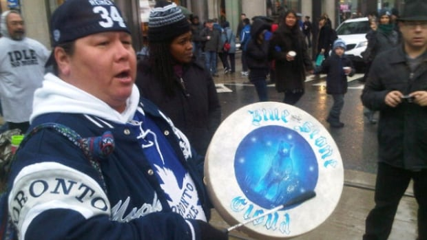 Drumming and singing at the Yonge-Dundas Intersection, flash mob round dance in Toronto, December 21, 2013