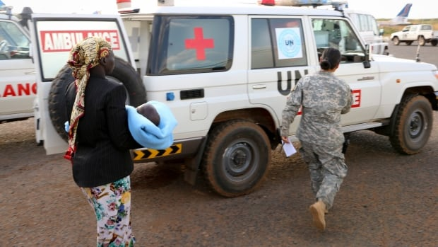 In this photo released by the United Nations Mission in South Sudan (UNMISS), wounded civilians from Bor, the capital of Jonglei state and said to be the scene of fierce clashes between government troops and rebels, are assisted after being transported by U.N. helicopter to Juba, South Sudan.