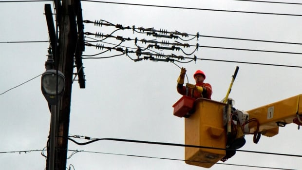A Horizon Utilities worker works to repair the power at Fennell and Upper Sherman after a pre-Christmas ice storm. Thousands of Hamilton residents were without power. The city is still calculating how much the damage has cost Hamilton.