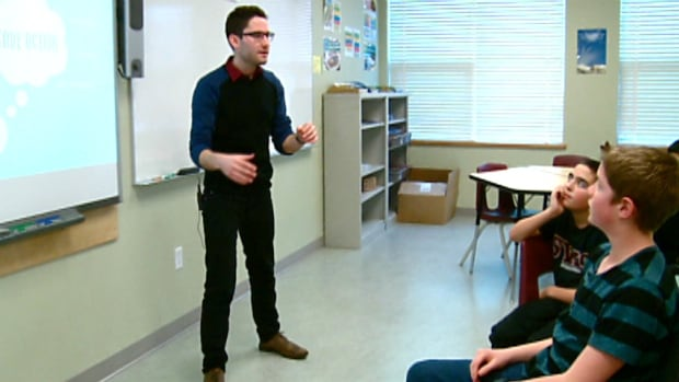 Nursing student Jonathan Dennis talks to students about how to fight against cyberbullying.