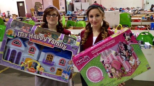 Elves Mikaela Mill and Lauren Vernaleken prepare to deliver presents to less fortunate families and seniors' homes.