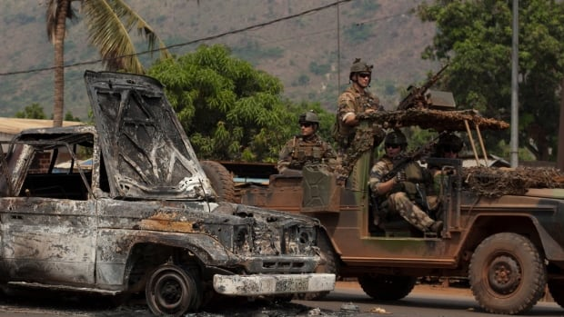 A total of six Chadian soldiers from the African Union peacekeeping force were killed on Christmas Day in the Gobongo neighbourhood of the capital, the AU said. Their destroyed car, with some of their remains, had still not been removed a day later.