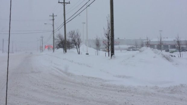 Road conditions were rough on Stavanger Drive in St. John's on Friday, as snow continued to fall into the late morning.