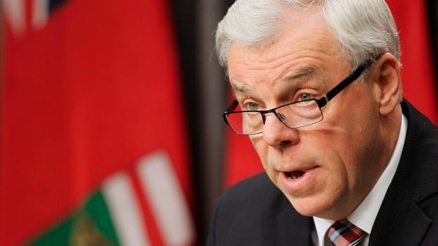 Manitoba Premier Greg Selinger, seen delivering last November's throne speech, blames the hike in the provincial sales tax for the NDP's slide in the polls.
