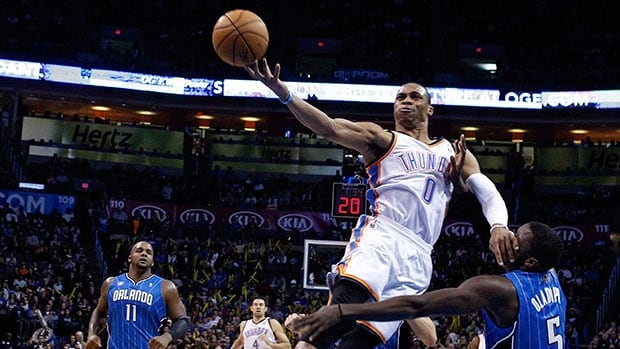 Oklahoma City Thunder guard Russell Westbrook, top, attempts a layup over Orlando Magic guard Victor Oladipo during a game in Oklahoma City on Dec. 15, 2013.
