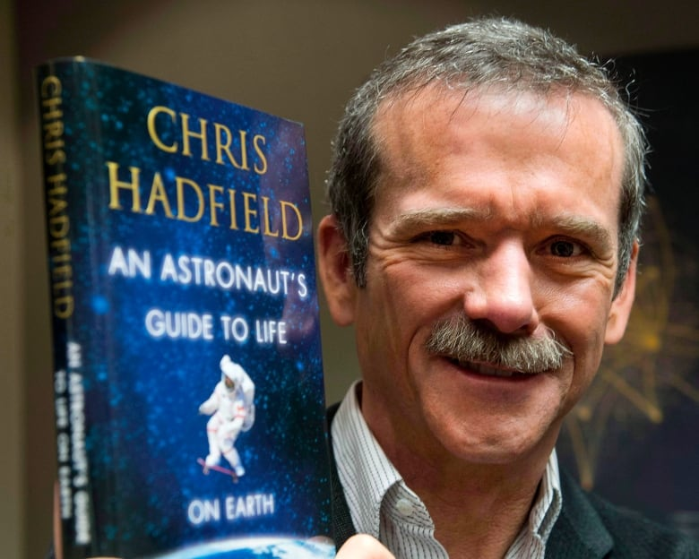 Astronaut Chris Hadfield launches space photo book | CBC News