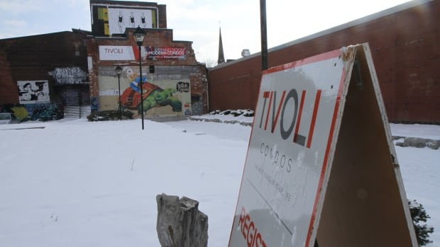 A sign sitting on a lot on James Street North in downtown Hamilton advertises a condo building that is being planned for the site. A developer says more details about the complex, which will include a restored Tivoli Theatre, will be announced in January.