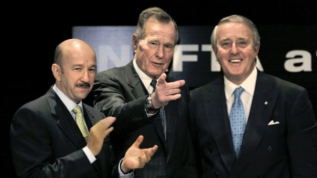 Former Mexican President Carlos Salinas de Gortari, left, former U.S. President George H.W. Bush, center, and former Canadian Prime Minister Brian Mulroney, right, gather for a conference on NAFTA at the Woodrow Wilson International Center for Scholars in Washington in December 2002.