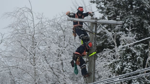 Power crews work Sunday in St. George, N.B. There are worries a storm that hit New Brunswick overnight will hamper restoration efforts.