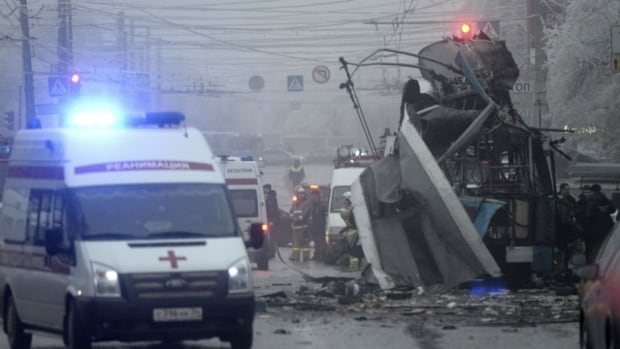 Members of the emergency services work at the site of a bomb blast on a trolleybus in Volgograd on December 30, 2013.