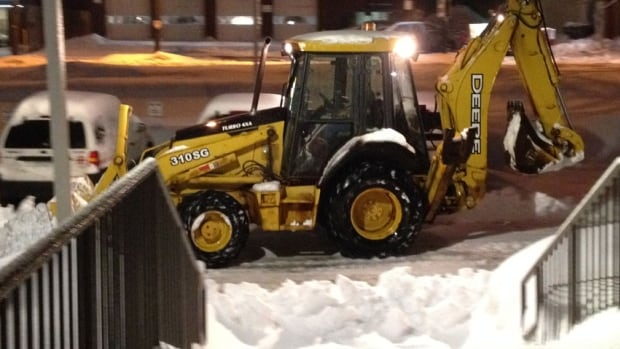 Crews were out around the province clearing snow Monday morning.