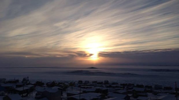 The sun over Frobisher Bay at noon. Homeowners in Nunavut are bracing for a hike of 10 cents per litre in diesel, the fuel many use to heat their homes.