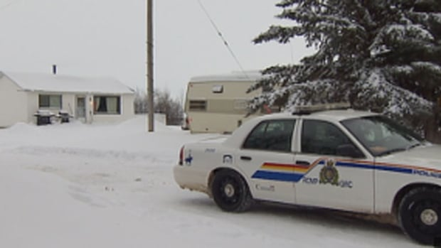 An RCMP cruiser sits outside a home near Busby, Alta. where two men were found dead on Saturday night.