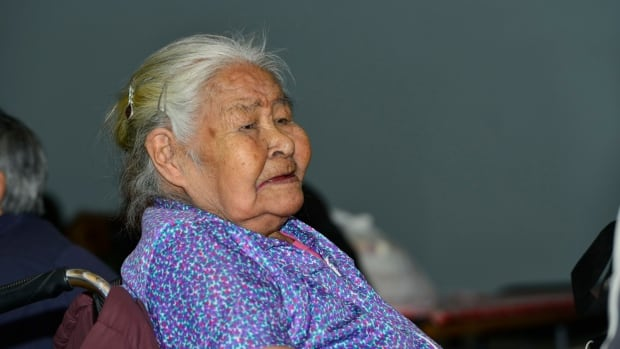 Artist Elisapee Ishulutaq attends an elders Christmas dinner in Pangnirtung, Nunavut. Ishulutaq is the last living artist who contributed to the community's first print collection in 1973.