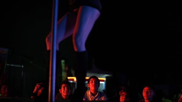 The federal government will no longer allow Canadian employers to hire foreign strippers such as this exotic dancer, seen here performing in Mexico City, to work in Canada.