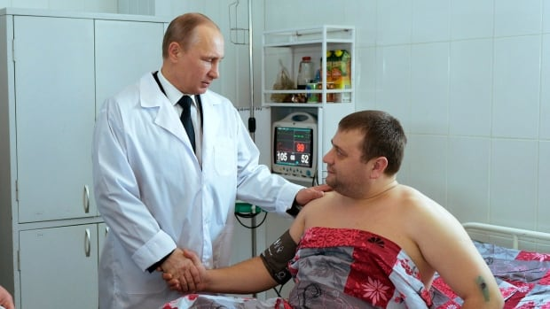 Russian President Vladimir Putin greets a victim of recent suicide bombings as he visits a hospital in Volgograd.