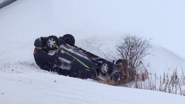 Freezing rain was creating problems on area roads and may have caused this rollover on Highway 16.
