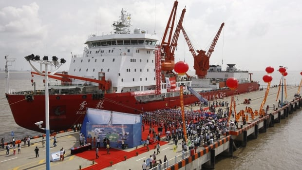 Chinese icebreaker Xuelong, or Snow Dragon, is shown harbored in Shanghai in September 2012. The ship became stuck in sea ice near Antarctica after rescuing researchers and tourists from a Russian ship that had become trapped in heavy ice.
