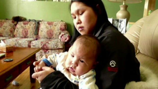 Aalaa Surusimmituq Michael, 23, with her two-year-old son Cory. The pair were found dead in their home in March of 2013. A special blessing will take place today before the home is re-opened as a unit for transient workers.