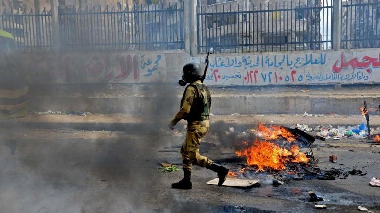 11 Egyptian protesters killed in clash with police | CBC News