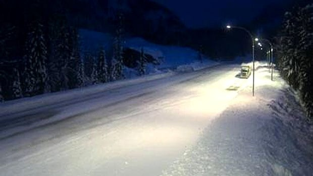 A truck is surrounded by fresh snow in Albert Canyon, about 30 kilometres east of Revelstoke, B.C., on Highway 1.
