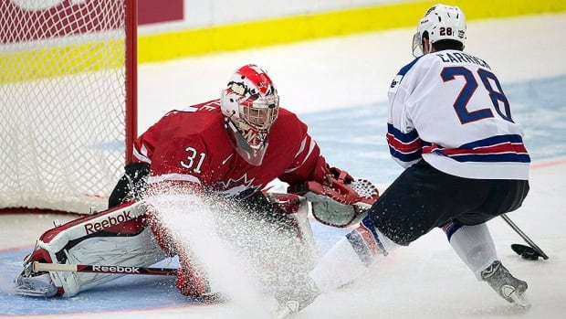 Canada's Sam Reinhart screens a shot on Finland's goalie Juuse Saros during first period semifinal IIHF world junior hockey play in Malmo, Sweden, on Saturday. Frank Gunn/Canadian Press