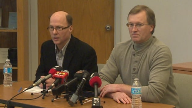 Rob Henderson of Newfoundland and Labrador Hydro and Gary Smith of Newfoundland Power speak to reporters in St. John's on Friday afternoon.