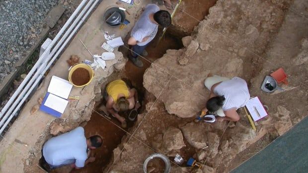Archeologists dig at a Neanderthal dwelling site in northwest Italy. Recent evidence from the site suggests that Neanderthals organized their living spaces for different purposes.