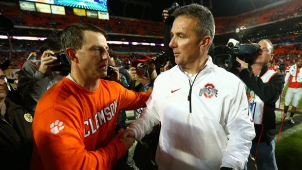 Head coach Dabo Swinney of the Clemson Tigers, left, and head coach Urban Meyer of the Ohio State Buckeyes, right, shake hands after the the Discover Orange Bowl at Sun Life Stadium in Miami Gardens, Florida.