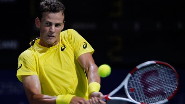 Canada's Vasek Pospisil plays a shot against Stanislas Wawrinka of Switzerland in their semifinal match at the ATP Chennai Open in Chennai, India, on Saturday.