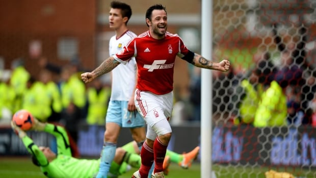 Andy Reid of Nottingham Forest celebrates as he scores their fifth goal during the FA Cup against West Ham United at City Ground on Sunday in Nottingham, England.