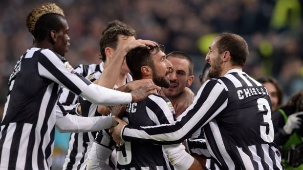 Mirko Vucinic of FC Juventus, centre, celebrates scoring the third goal against AS Roma at Juventus Arena on Sunday in Turin, Italy.