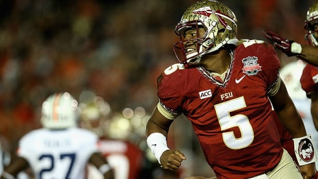 Quarterback Jameis Winston of Florida State celebrates his game-winning touchdown against Auburn in the final moments of the Rose Bowl. Winston has avoided criminal charges after a woman said he sexually assaulted her.