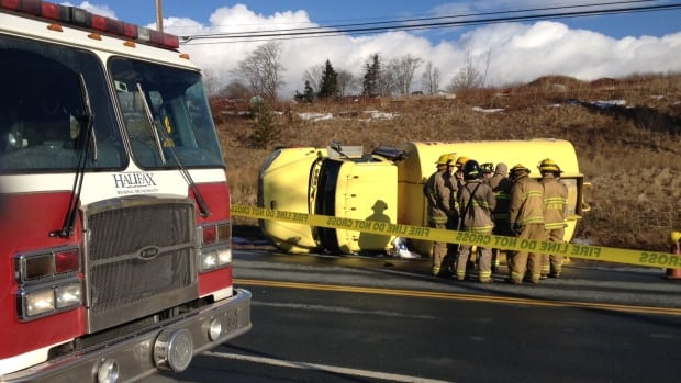 Officials are trying to figure a cleanup plan after a fuel truck flipped on Pleasant Street.