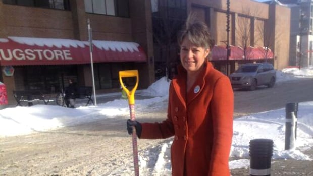 Wendy Lees decided to place community snow shovels at an East Village intersection to help with snow-covered walkways.