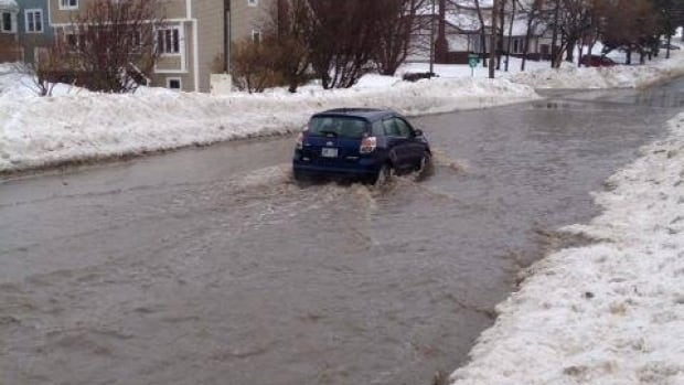 Carpasian Road in St. John's was difficult to navigate on Tuesday, as rain and melting snow poured downhill from separate directions.