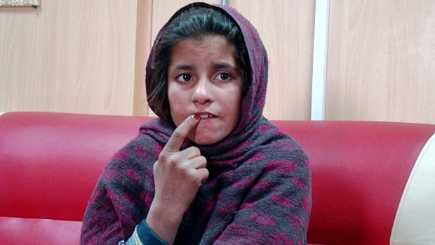 An Afghan girl named Spozhmai is held in a border police station in the southeastern part of Helmand province, Afghanistan. The 10-year-old told police that her brother, who she said was a Taliban commander, wrapped her in an explosives-packed vest but that she refused to blow herself up at a police checkpoint. The Taliban denied the alleged plot.