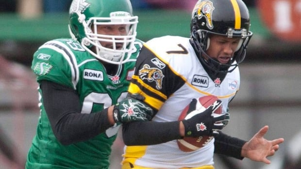 Tiger-Cats kicker Justin Medlock, right, left the team for the NFL's Carolina Panthers following the 2011 season. Hamilton announced Wednesday he has signed a contract to return to the club.