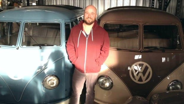 Volkswagen fan Ken King with two of his immaculately restored micro buses. The last VW vans rolled off the assembly line last week.