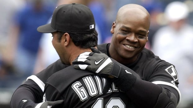 Former player and manager of the Chicago White Sox Ozzie Guillen, left, was one of many that expressed their congratulations through social media to newly-elected Hall of Famers Frank Thomas, right, as well as Greg Maddux and Tom Glavine.