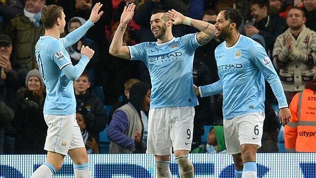 Manchester City striker Alvaro Negredo (C) celebrates with teammates after scoring against West Ham.