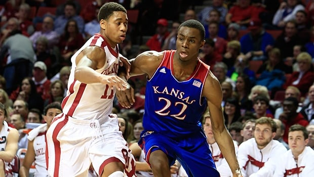 Kansas guard Andrew Wiggins, right, drives around Oklahoma guard Isaiah Cousins during the first half in Norman, Okla., Wednesday, Jan. 8, 2014.