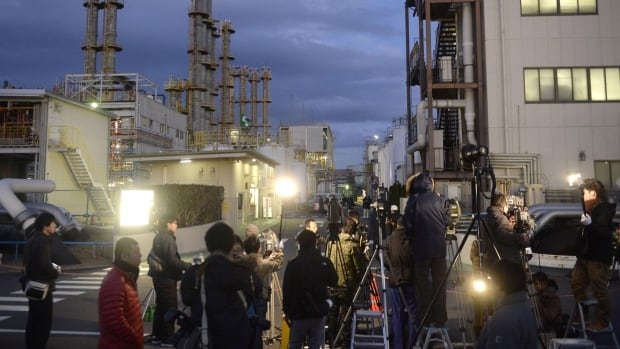Local press members gather at an entrance to Mitsubishi Materials Corp.'s chemical factory following an explosion in Yokkaichi, central Japan, on Thursday.